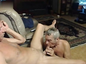 Mature mustache daddy enjoying a blowjob by his buddy