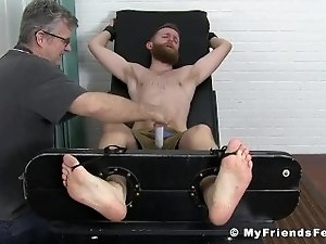Bound sub endures tickling by masters hands and toys