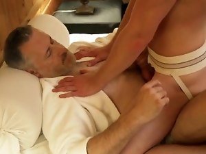 Silver daddy fucks young stud in a hotel room